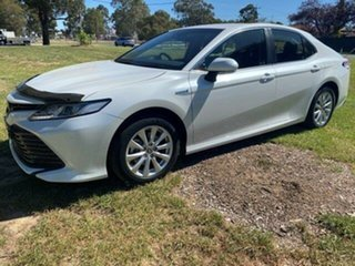 2020 Toyota Camry Hybrid Frosted White Sedan.