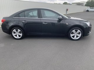 2009 Holden Cruze JG CDX Black 6 Speed Sports Automatic Sedan.