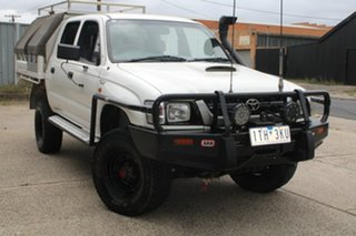 2004 Toyota Hilux KZN165R (4x4) White 5 Speed Manual Dual Cab Chassis.