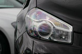 2011 Nissan Dualis J10 Series II MY2010 ST Hatch Purple 6 Speed Manual Hatchback.
