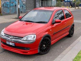 2003 Holden Barina XC SRi Red 5 Speed Manual Hatchback.