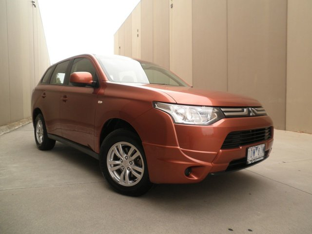 Used Mitsubishi Outlander ZJ MY13 ES 4WD Cheltenham, 2012 Mitsubishi Outlander ZJ MY13 ES 4WD Sunburnt Orange 6 Speed Constant Variable Wagon