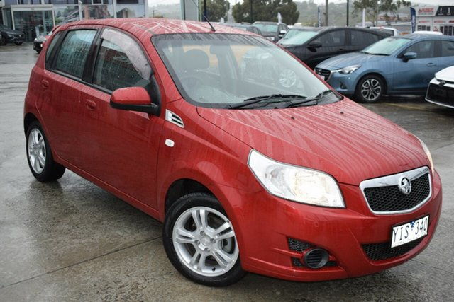 Used Holden Barina TK MY11 Ferntree Gully, 2011 Holden Barina TK MY11 Red 5 Speed Manual Hatchback