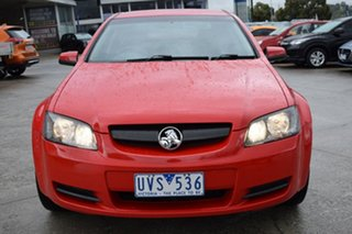 2006 Holden Commodore VE Omega Red/Black 4 Speed Automatic Sedan.
