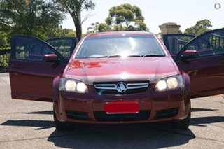 2008 Holden Commodore VE MY09.5 Omega (D/Fuel) 60th Ann Red 4 Speed Automatic Sedan.