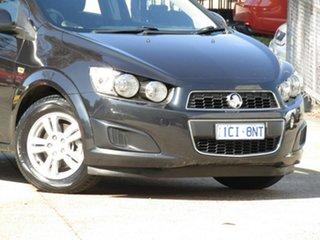 2014 Holden Barina TM MY14 CD 8 Ball Black 6 Speed Automatic Hatchback.