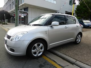 2005 Suzuki Swift EZ White 5 Speed Manual Hatchback.
