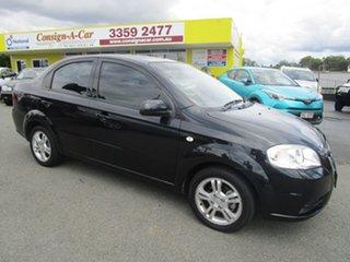 2010 Holden Barina TK MY11 Black 4 Speed Automatic Sedan.