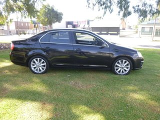 2010 Volkswagen Jetta 1KM 118TSI Black Sports Automatic Dual Clutch Sedan.