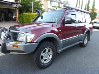 2003 Mitsubishi Pajero NP GLS LWB (4x4) Red & Silver 5 Speed Auto Sports Mode Wagon.