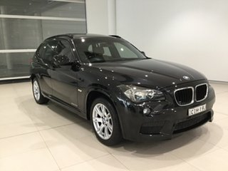 2011 BMW X1 E84 MY11.5 xDrive20d Steptronic Black Sapphire 6 Speed Sports Automatic Wagon.