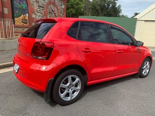 2010 Volkswagen Polo 6R 66TDI DSG Comfortline Red 7 Speed Sports Automatic Dual Clutch Hatchback.