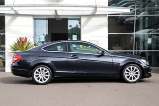 2011 Mercedes-Benz C-Class C204 C180 BlueEFFICIENCY 7G-Tronic + Black 7 Speed Sports Automatic Coupe.