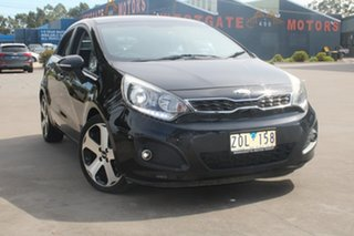 2013 Kia Rio UB MY13 SLi Black 6 Speed Manual Hatchback.