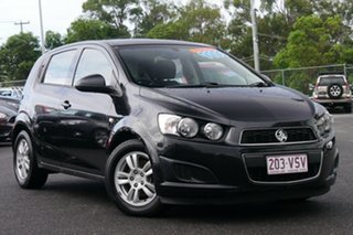2012 Holden Barina TM Black/Grey 5 Speed Manual Hatchback.