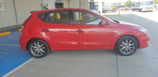 2012 Hyundai i30 FD MY11 Trophy Red 5 Speed Manual Hatchback.