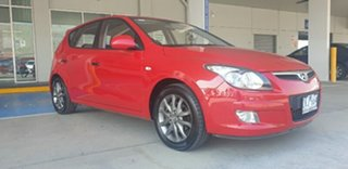 2012 Hyundai i30 FD MY11 Trophy Red 5 Speed Manual Hatchback.