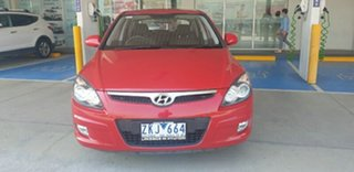 2012 Hyundai i30 FD MY11 Trophy Red 5 Speed Manual Hatchback