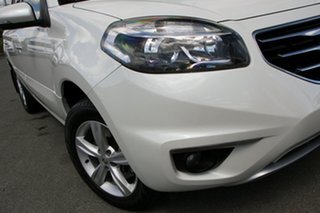 2011 Renault Koleos H45 MY11 Expression White Pearl 1 Speed Constant Variable Wagon.