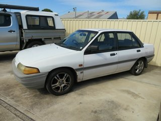 1992 Ford Laser White 5 Speed Manual Hatchback.