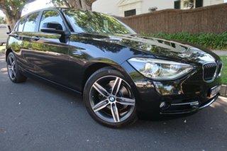 2014 BMW 1 Series F20 MY0713 118i Steptronic Black 8 Speed Sports Automatic Hatchback.