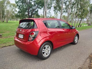 2012 Holden Barina TM Red 6 Speed Automatic Hatchback.