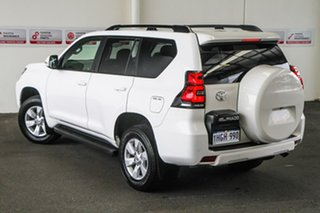 Toyota Landcruiser Prado Glacier White Wagon.