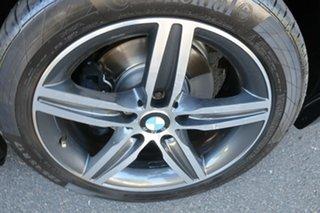 2014 BMW 1 Series F20 MY0713 118i Steptronic Black 8 Speed Sports Automatic Hatchback