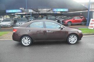 2010 Kia Cerato TD MY10 SLi Maroon 4 Speed Automatic Sedan.