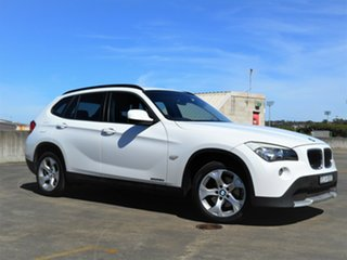 2011 BMW X1 E84 MY11 sDrive20d Steptronic White 6 Speed Sports Automatic Wagon.