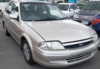 2000 Ford Laser KN LXI Gold Silver 5 Speed Manual Hatchback.