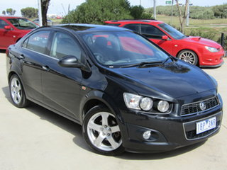 2013 Holden Barina TM MY13 CDX Black 6 Speed Automatic Sedan.