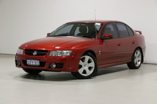 2006 Holden Commodore VZ MY06 SVZ Red 4 Speed Automatic Sedan.