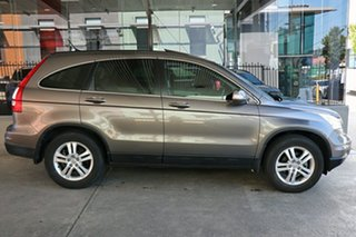 2011 Honda CR-V RE MY2011 Luxury 4WD Titanium 5 Speed Automatic Wagon.