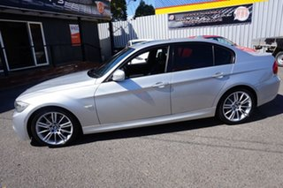 2011 BMW 3 Series E90 MY1011 320d Steptronic Lifestyle Titanium Silver 6 Speed Sports Automatic.