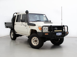 2014 Toyota Landcruiser VDJ79R MY12 Update Workmate (4x4) White 5 Speed Manual Double Cab Chassis.