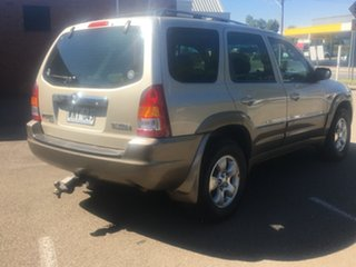 2001 Mazda Tribute Classic Gold 4 Speed Automatic Wagon.