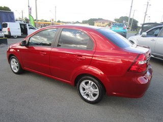 2011 Holden Barina TK MY11 Red 4 Speed Automatic Sedan.