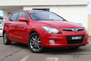 2012 Hyundai i30 FD MY11 SX Red 4 Speed Automatic Hatchback.