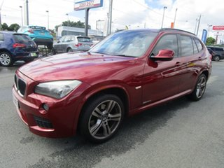 2011 BMW X1 E84 MY11.5 sDrive20d Steptronic Red 6 Speed Sports Automatic Wagon.