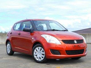 2013 Suzuki Swift FZ MY13 GA Orange 5 Speed Manual Hatchback.