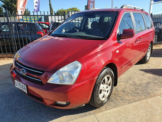 Used Kia Carnival VQ MY07 EX Luxury Morphett Vale, 2006 Kia Carnival VQ MY07 EX Luxury Red 4 Speed Sports Automatic Wagon