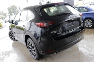 2018 Mazda CX-5 KF4WLA Akera SKYACTIV-Drive i-ACTIV AWD Black/White 6 Speed Sports Automatic Wagon.