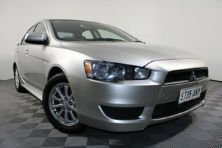 2011 Mitsubishi Lancer CJ MY11 ES Warm Silver 5 Speed Manual Sedan.