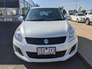 2014 Suzuki Swift White 5 Speed Automatic Hatchback.