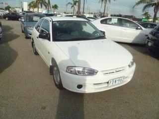 1998 Mitsubishi Mirage CE White 5 Speed Manual Hatchback.