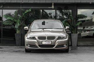 2011 BMW 3 Series E90 MY1011 320i Steptronic Lifestyle Beige 6 Speed Sports Automatic Sedan.