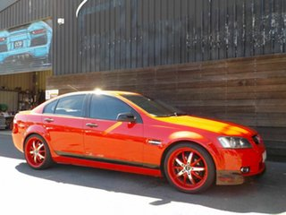 2007 Holden Commodore VE Omega Red 4 Speed Automatic Sedan.