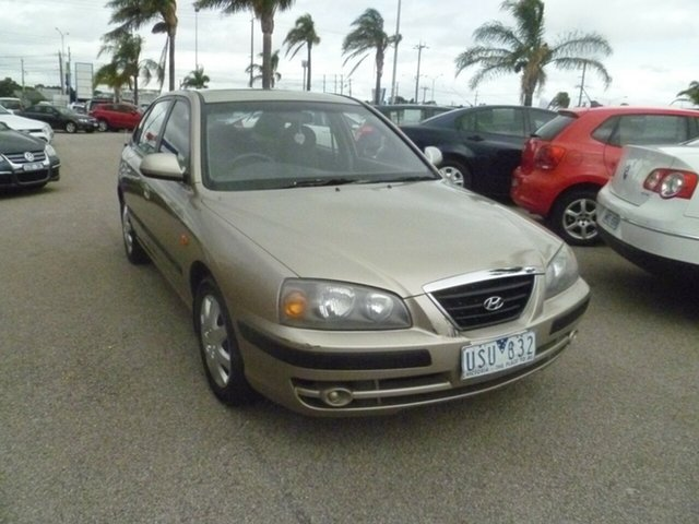 Used Hyundai Elantra XD MY05 Moorabbin, 2005 Hyundai Elantra XD MY05 Gold 4 Speed Automatic Hatchback