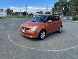 2006 Suzuki Swift RS415 GLX Orange 4 Speed Automatic Hatchback.